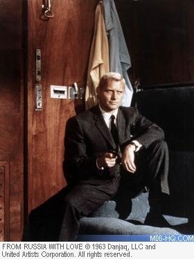 Grant points his gun at Bond
